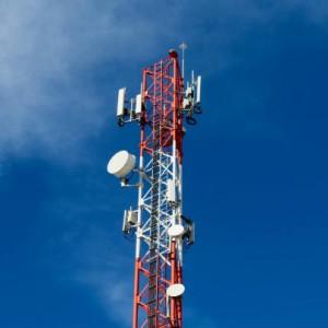 Cuatro firmas en venta de torres de telecomunicaciones de Tigo a ATC en Colombia